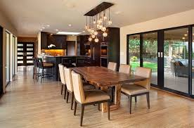 small glass pendant lamps for contemporary dining room decor ideas with unique wooden table and leather