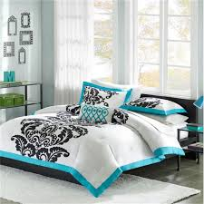 update your bedroom decor with this teal duvet cover set from mizone santorini the four piece set includes a coordinating duvet two shams