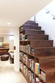 12 Gorgeous Ways to Organize Your Bookshelves | Staircase bookshelf,  Staircases and Basements