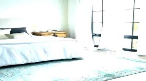 rug underneath bed area under rugs big beds placing