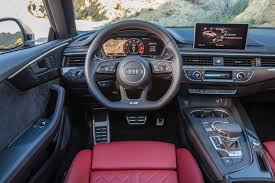 2018 audi models. interesting 2018 inside both models is a threespoke flatbottom and sportdesigned  multifunction steering wheel with shift paddles plus threezone automatic  and 2018 audi