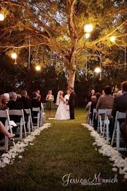 I love the evening ceremony under a big tree with lights hanging from the  tree. More lights though!