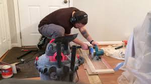 making a straight cut across hardwood flooring boards with a zero clearance circular saw jig