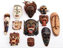 Lot - A group of <b>eleven</b> polychromed carved decorative <b>masks</b>