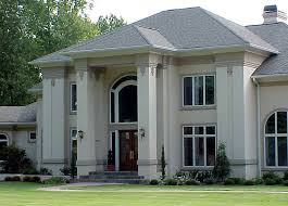 Dramatic Exterior with Flattened Columns and White Stucco Finish