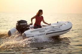 woman driving a dinghy