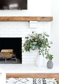 get inspired the white brick fireplace love this rustic modern version diy floating mantel