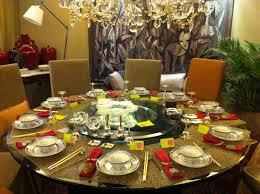 casual dinner table set on round table with glass countertop with asian nuance with bowls and chopsticks and yellow namecards