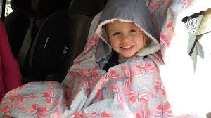 the back of the poncho just ds up and over the back of the car seat