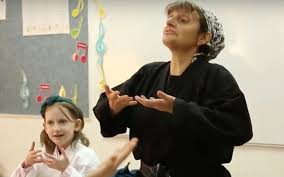 jill shames director of and certification at kids kicking cancer teaching children breathing