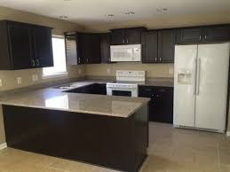 bainbrook brown granite with white cabinets
