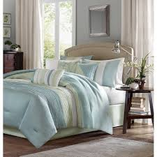 this duvet cover is covered in larges stripes in shades of green and blue made from polyester jacquard and a brushed fabric reverse this comforter is soft