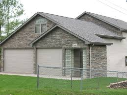 b cultured stone for a traditional exterior with a garage doors and b cultured stone limestone