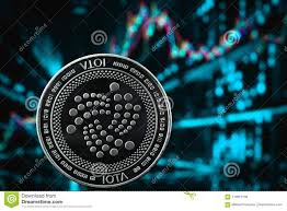Iota Coin Cryptocurrency On The Chart Background Stock Photo