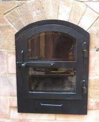 cob cottage masonry heater door