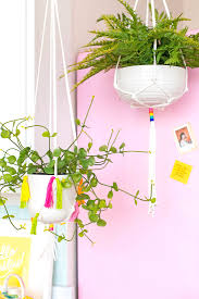 after our colorful kitchen reveal i got a ton of requests from people to do a diy tutorial on these fun planters we made so today we are going to show