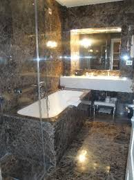 the first roma bathtub next to the standup shower