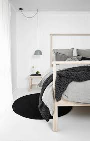 lighting bed. Suspended Matte Gray Bedside Lamp In A Minimal Monochromatic Nordic Bedroom | NONAGON.style Lighting Bed