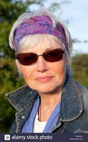 Mature Woman With Grey Hair And Sunglasses Portrait Stock Photo