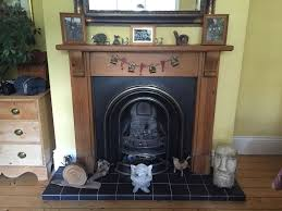 victorian cast iron fireplace with wooden surround and gas burner optional
