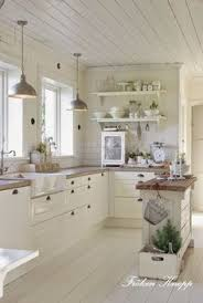 stainless steel sink racks ampquot whitehaven: wood pannelling traditional cupboards metal lampshades but what i like most is the shelving and total lack of wall units white kitchen love
