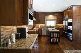 kitchen remodeling example with dark cherry cabinets center work island and granite countertops