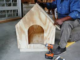 step 5 man constructs a doghouse