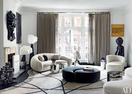 how to incorporate ottomans into your living room decor photos architectural digest