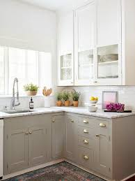 dove gray kitchen cabinets with cup pulls