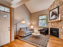the gorgeous two story stone faced fireplace and vaulted ceilings welcome you in
