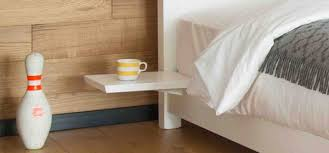 floating shelves on wooden beds
