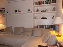 Enjoyable White Painted Open Shelves For Storage And Bookcase Over  Sectional Pull Down Bed As Space Saving Interior Small Bedroom Designs