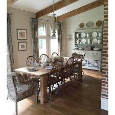farmhouse dining room love the exposed beams and the huge farmhouse table eclecticallyvine