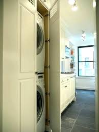 washer and dryer in master closet how to hide laundry room plumbing