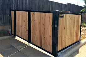 wood and metal fence apartment trash receptacle barrier framed corrugated plans