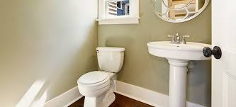 bathroom cabinet with a pedestal sink