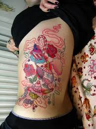 makeup tattoo design on rib