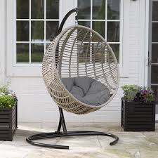 com resin wicker kambree rib breezy driftwood finish hanging egg chair with cushion and stand garden outdoor