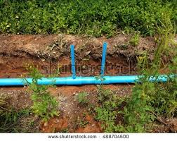plumbing embedded underground with blue pvc pipe soil was dug for water transportation by pipeline l16
