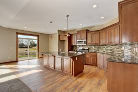 Hardwood Flooring Trends We Can Expect To See In 2018  ProCore  Blonde Hardwood Floors With A Dark Kitchen