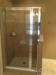 framed inline glass door panel shower enclosure with chrome hardware finish