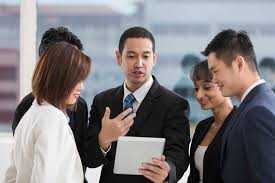 working as a team business team working together retail news asia