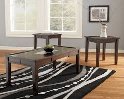 coffee table end set there are three tables and two small of dark wood shades gray