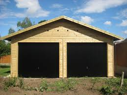 20 x 20 garage with black up over doors in the gable end
