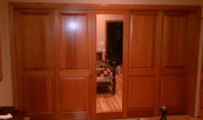 combination of colonial raised panel and mirror sliding doors