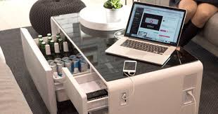 refrigerator table. besides having a refrigerator, it also has bluetooth speakers, charging ports, and connects with your tv. dreams do come true. refrigerator table e
