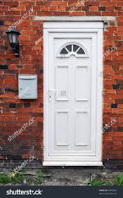 white front door. White Front Door Of A Red Brick English Town House