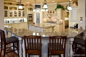 with its large wrap around countertop and island its cottage style glass cabinets and red stained bar chairs this kitchen is open