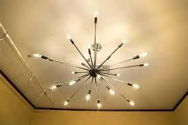filament design lighting exposed light bulb chandelier the exposed light bulb chandelier and hanging filament bulbs