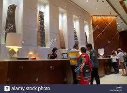 singapore fairmont singapore hotel lobby check in desk reservations asian woman employee sculptures art service inside interior